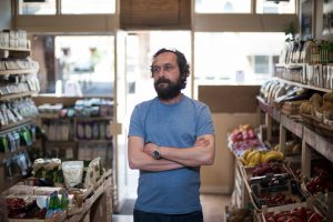 Tolga - Owner of Harvest grocery store, London - Donates food that woud otherwise go to waste
