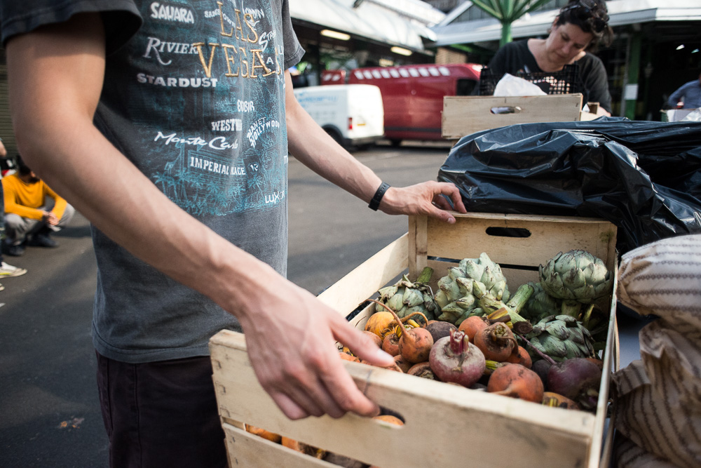 Gathering surplus food from Borough Market - Documenting Food Waste by Photographer Chris King